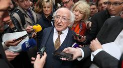 President Michael D Higgins canvases for votes on Dublin's Grafton Street (Niall Carson/PA)