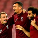 One for all: Liverpool's Xherdan Shaqiri, Dejan Lovren and Mo Salah share a light-hearted moment during training in Naples last night. Photo: AFP/Getty Images