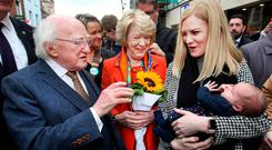 Meet and greet: Michael D Higgins and wife Sabina meet Rosie Valentine and her daughter Lilly, from Templeogue, on Grafton Street. Photo: Steve Humphreys
