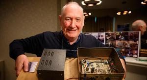 Declan Meehan holding a Radio Transmitter in a biscuit tin. Dublin City University will hold the Irish Pirate Radio Archive in the O'Reilly Library, DCU. Photo: Mark Condren