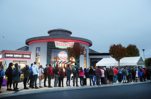 People queue outside Krispy Kreme's at 6:30.am at the official opening of Krispy Kreme's first ever Irish store in Blanchardstown Centre. Photo: Leon Farrell/Photocall Ireland.