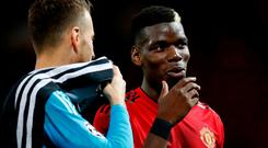 Manchester United Paul Pogba (right) and Valencia's Murara Neto speak after the UEFA Champions League, Group H match at Old Trafford