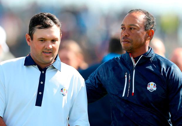 Team USA's Patrick Reed and Tiger Woods