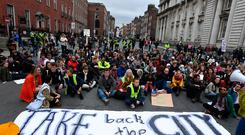People block traffic by staging a sit down protest at Ireland's housing crisis in a 'Raise the Roof' rally outside the Taoiseach's office at Government buildings in Dublin, Ireland. REUTERS/Clodagh Kilcoyne