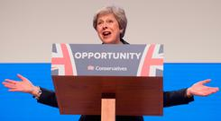 Pressure: British Prime Minister Theresa May makes her speech at the Conservative Party annual conference. Photo: PA