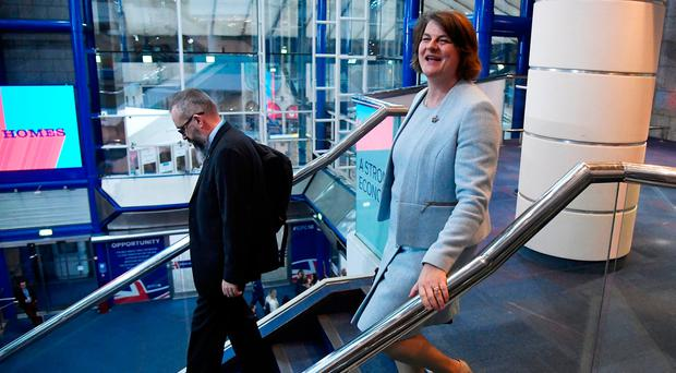 Arlene Foster, the leader of the Democratic Unionist Party, walks through the venue of the Conservative Party Conference in Birmingham. REUTERS/Toby Melville