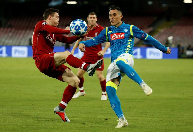 Liverpool's Andrew Robertson and Napoli's Jose Callejon challenge for the ball. Photo: Reuters