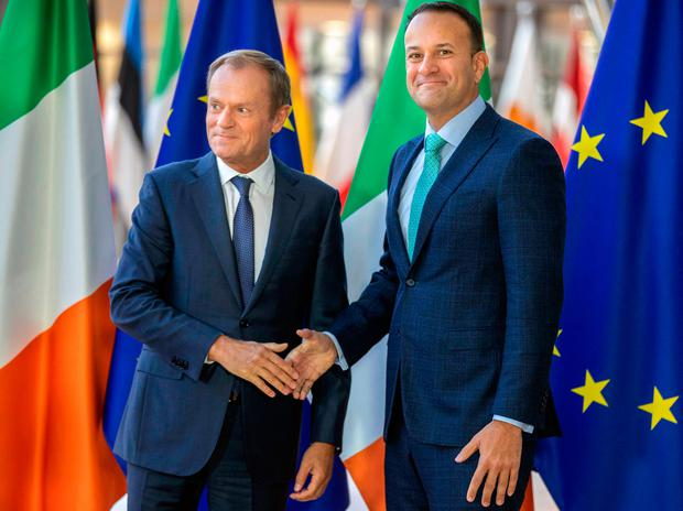 European Council President Donald Tusk, left, and Irish Prime Minister Leo Varadkar arrive before their meeting at the European Council headquarters in Brussels, Thursday, Oct. 4, 2018. (AP Photo/Olivier Matthys)