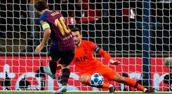 Hugo Lloris is powerless to prevent Lionel Messi scoring his second goal of the night in Barcelona's victory over Tottenham. Photo: Getty Images