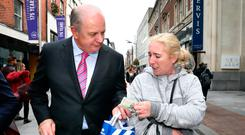 A helping hand: Presidential candidate Gavin Duffy donates €20 to Vivienne Keogh from Dublin for the 'Just Ask' fund, which is bringing 20 teenagers to Morocco to work in an orphanage. Photo: Frank McGrath