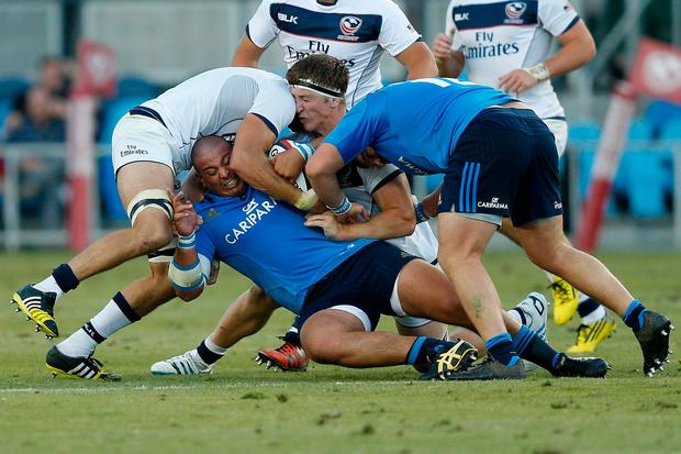 Sami Panico of Italy is tackled