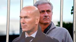 Cardboard cut-outs of French coach Zinedine Zidane (L) and Manchester United's Portuguese manager Jose Mourinho are pictured before the English Premier League football match between Manchester United and Newcastle at Old Trafford