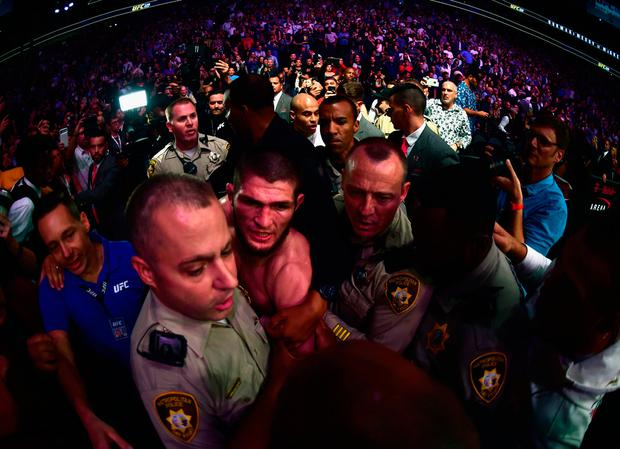 Khabib Nurmagomedov is escorted out of the arena after defeating Conor McGregor