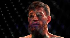 Conor McGregor looks on in the octagon before competing against Khabib Nurmagomedov