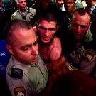 Khabib Nurmagomedov of Russia is escorted out of the arena after defeating Conor McGregor of Ireland in their UFC lightweight championship bout during the UFC 229 event inside T-Mobile Arena on October 6, 2018 in Las Vegas, Nevada. (Photo by Harry How/Getty Images)