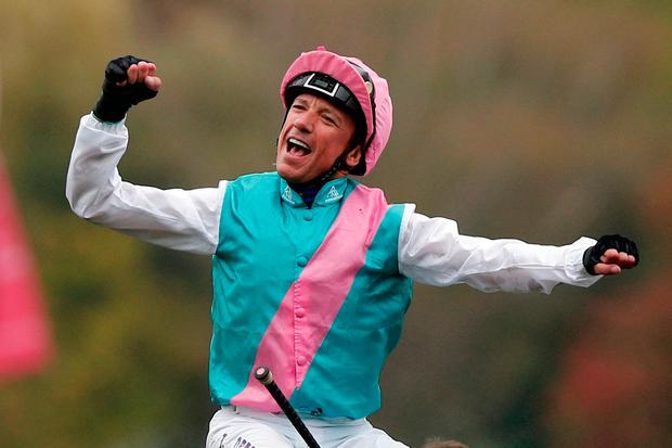 Frankie Dettori celebrates after just holding on from Sea Of Class to win the Prix d'Arc de Trtiomphe on Enable. AP Photo/Francois Mori