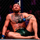 Conor McGregor sits in the ocotgon after his defeat to Khabib Nurmagomedov at T-Mobile Arena in Las Vegas on Saturday night. Photo by Stephen McCarthy/Sportsfile