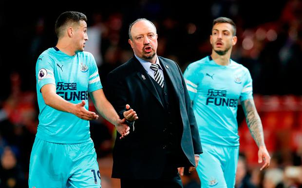 Newcastle United manager Rafael Benitez speaks with Javier Manquillo (left) after the Premier League match at Old Trafford. Photo: Martin Rickett/PA