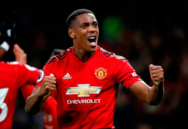 Manchester United's Anthony Martial celebrates at the final whistle. Photo: Martin Rickett/PA