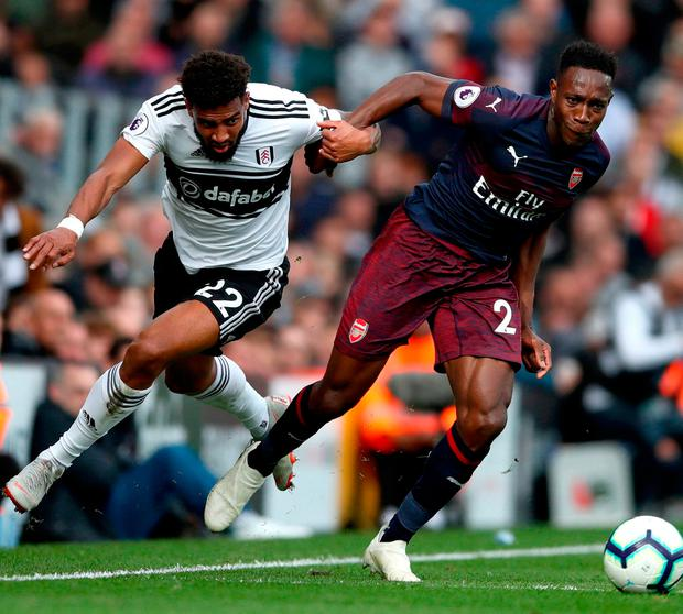 Arsenal's Danny Welbeck gets past Fulham's Cyrus Christie at Craven Cottage. Photo: John Walton/PA