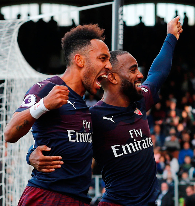 Arsenal's Pierre-Emerick Aubameyang celebrates scoring their fourth goal with Alexandre Lacazette. Photo: Eddie Keogh/Reuters