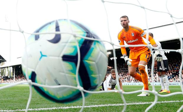 Fulham's Marcus Bettinelli looks on as Arsenal's Aaron Ramsey scores their third goal. Photo: Eddie Keogh/Reuters