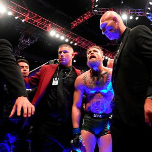 ESCORTED OUT: Conor McGregor leaves the Octagon following defeat to Khabib Nurmagomedov and the attack. Photo: Stephen McCarthy/Sportsfile