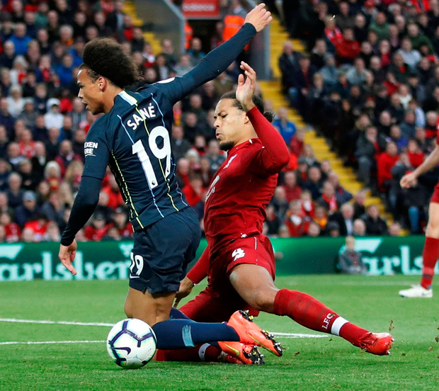 Liverpool's Virgil van Dijk tackles Leroy Sane which leads to Manchester City being awarded the late penalty. Photo: Carl Recine/Reuters