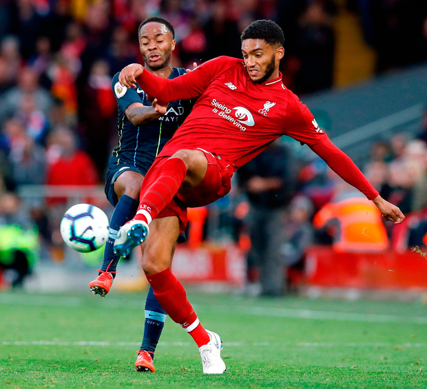 Manchester City's Raheem Sterling (left) and Liverpool's Joe Gomez battle for the ball at Anfield. Photo: Martin Rickett/PA