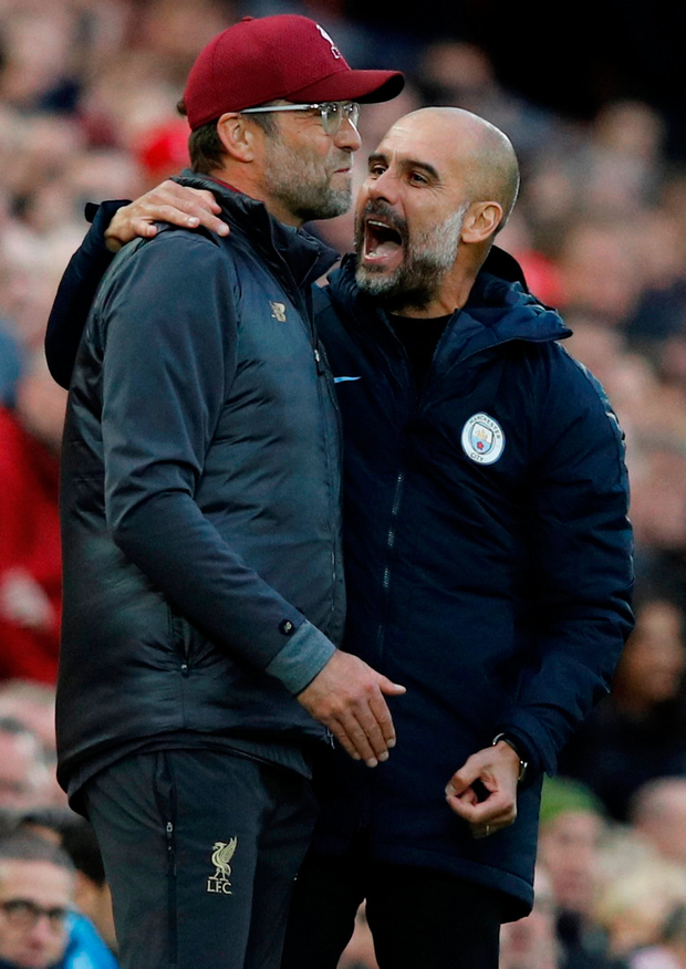 Liverpool manager Juergen Klopp with Manchester City manager Pep Guardiola during the match. Photo: REUTERS/Phil Noble/Reuters