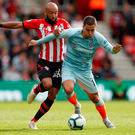 Chelsea's Eden Hazard battles with Southampton's Nathan Redmond. Photo: John Sibley/Reuters