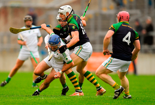 Brian Carroll of Coolderry in action against Kilcormac/Killoughey players, from left, Stephen Leonard, Conor Mahon, and Killian Leonard. Photo by Piaras Ó Mídheach/Sportsfile