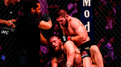 Referee Herb Dean stops the fight between Conor McGregor and Khabib Nurmagomedov at the T-Mobile Arena. Photo by Stephen McCarthy/Sportsfile