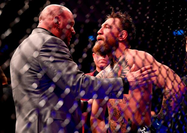 Beaten: Conor McGregor with UFC boss Dana White after his defeat in Las Vegas. Photo: Stephen McCarthy/Sportsfile
