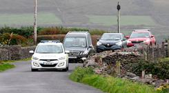 Coming home: The coffin of Emma Mhic Mhathúna arrives in Baile na nGall in Co Kerry yesterday. Photo: Domnick Walsh
