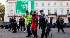 Protest: An activist is arrested at the German Embassy in London yesterday in a protest against coal. Photo: Jack Taylor/Getty Images