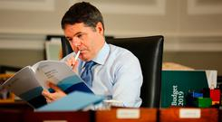 Finance Minister Paschal Donohoe reviews Budget 2019 in his office in the Department of Finance ahead of today's presentation to the Dáil. Photo: Gerry Mooney