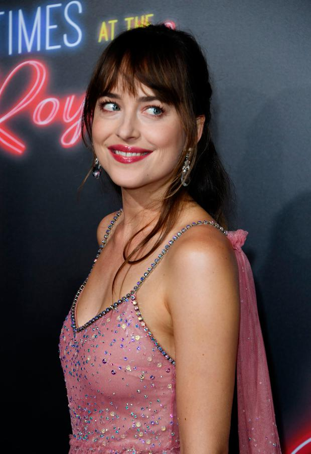 Actress Dakota Johnson arrives for the premiere Of 20th Century FOX's Bad Time at the El Royale at the TCL Chinese Theater i Hollywood, California on September 22, 2018. (Photo by Mark RALSTON / AFP)