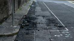 The scene in Bonham street where a car involved in a carjacking from St James's Hospital was burned out.