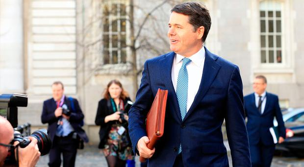 Minister Paschal Donohoe arrives at Government buildings with Budget 2019. Photo: Gerry Mooney