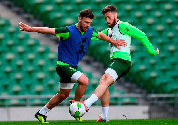 Scott Hogan attempts to get past Matt Doherty during yesterday's training session at the Aviva Stadium. Photo: Stephen McCarthy/Sportsfile