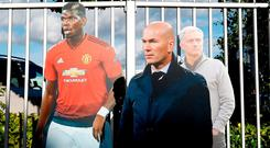 Life-size cut-outs of Paul Pogba, Zinedine Zidane and Jose Mourinho at Old Trafford prior to the victory over Newcastle. Photo: PA