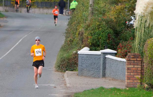 LONG' RUN: Gary O'Hanlon in first position with Eoin Callaghan (in the background) in second at the Irish 3/4 Marathon that took place last week in Longwood, Meath