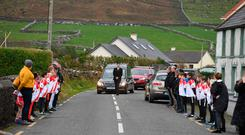 Heart-breaking: Emma Mhic Mhathúna's coffin arrives at the church in Kerry. Photo: Domnick Walsh