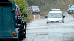 Traffic tries to navigate floods on the Castlebar to Belmullet road in Co Mayo yesterday. Picture: Paul Mealey