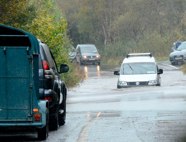 Traffic tries to navigate floods on the Castlebar to Belmullet road in Co Mayo yesterday