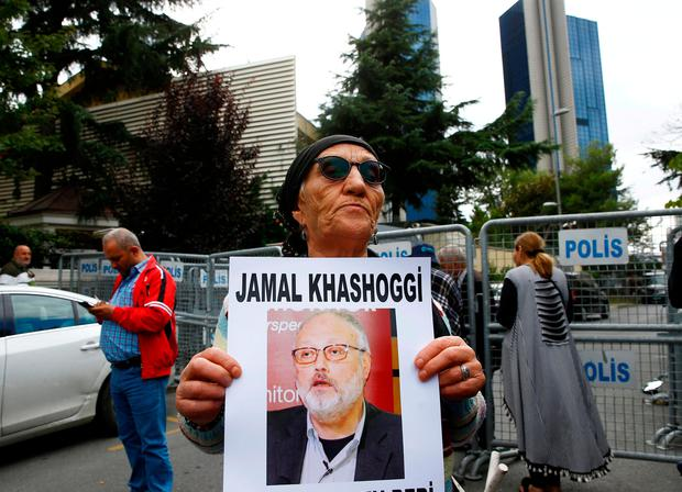 A human rights activist holds a picture of Saudi journalist Jamal Khashoggi during a protest outside the Saudi Consulate in Istanbul, Turkey. REUTERS/Osman Orsal