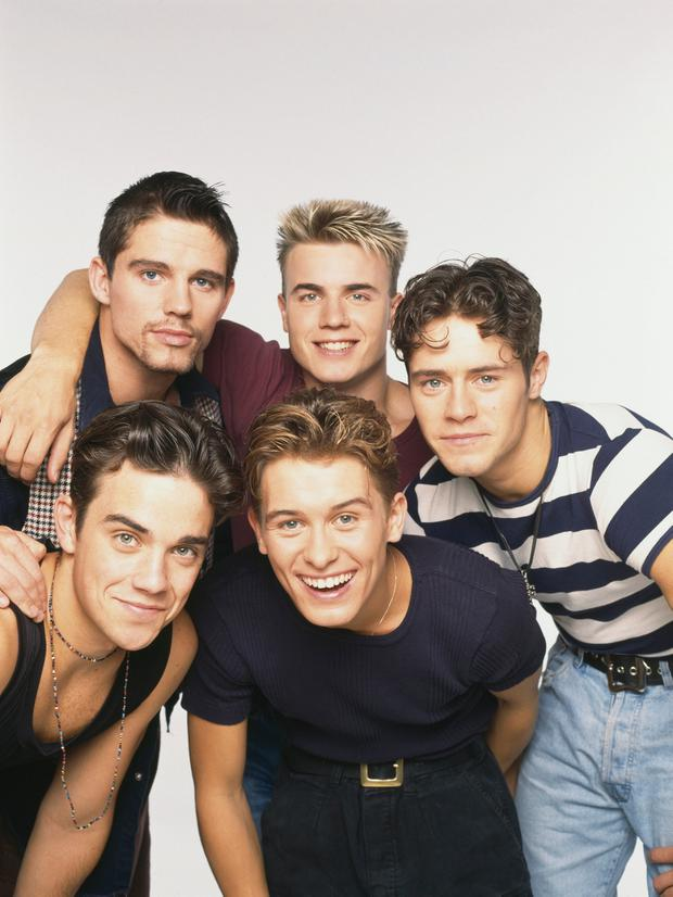Take That, circa 1992. Clockwise, from top left: Jason Orange, Gary Barlow, Howard Donald, Mark Owen and Robbie Williams. Photo: Tim Roney/Getty Images