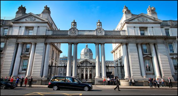 The remains of Emma Mhic Mhathúna pass by Government Buildings after her funeral mass ast the Pro Cathedral in Dublin. Pic Steve Humphreys