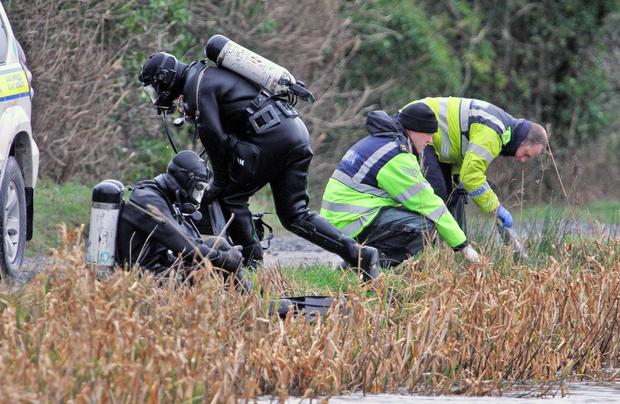 Garda underwater unit members search the canal near Sallins in 2016 for the body of Kenneth O'Brien. Picture: Collins